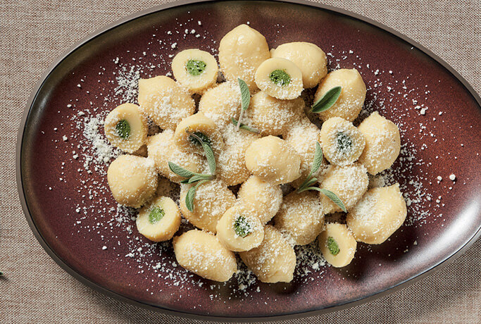 Potato gnocchi stuffed with ricotta and spinach with butter and sage