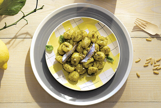 Potato gnocchi with pesto and fresh anchovies